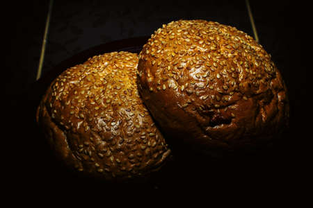 Hamburger bun with cinnamon on a dark background