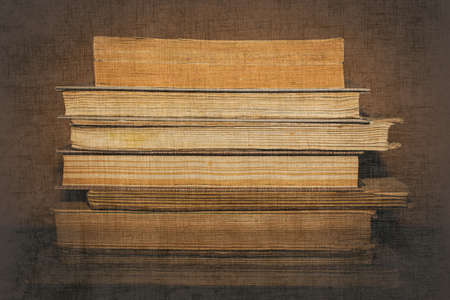 stack of books on wooden background 版權商用圖片