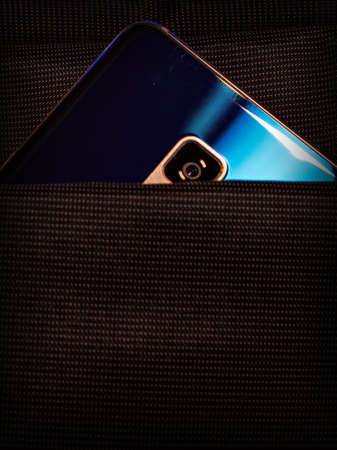 blue mobile phone with a camera in a bag pocket Stockfoto