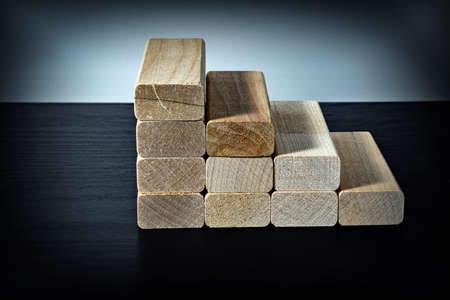 Wooden blocks in the form of steps. Ladder career path concept for business growth success process.