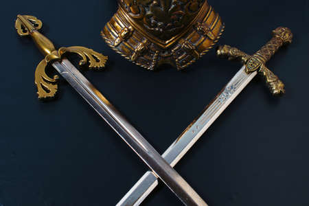 two crossed knightly swords on a black background Stockfoto