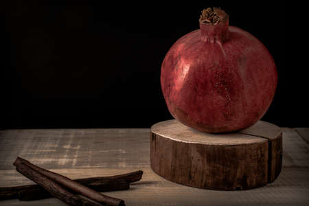 red pomegranate on wooden table