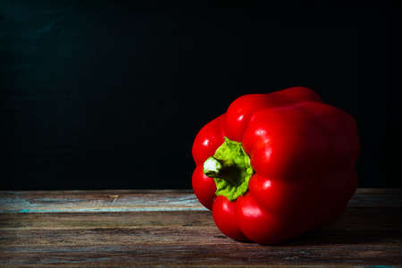 red pepper on wooden board
