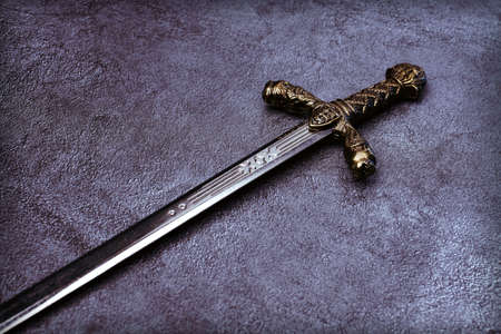 Knights hilt on a gray marble background