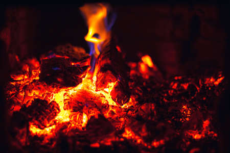 Abstract background with glowing embers of red color. Hot coals of burning wood. Standard-Bild