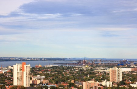 Still Picture of part of Hamilton, Ontario, Canada with industrial area and the Lake Ontario with silhouette of Toronto and CN Tower on background.  photo