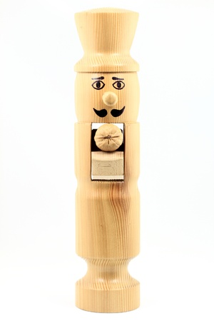 Picture of wooden (not painted plain wood) nutcracker shaped and drown as man ready to crack a walnut over white background.