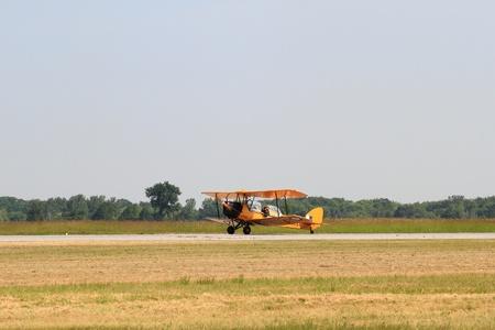aileron: HAMILTON, CANADA – JUNE 18: Vintage biplane de Havilland Tiger Moth taxes to start line on June 18, 2011 in Hamilton, Ontario, Canada. Hamilton Airshow at John S. Munro Hamilton International Airport