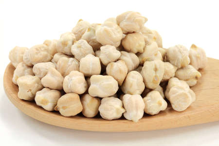 garbanzo bean: Dry Raw Chick Peas Seeds (very rich of proteins) spilled on pile in wooden cooking spoon over white background.
