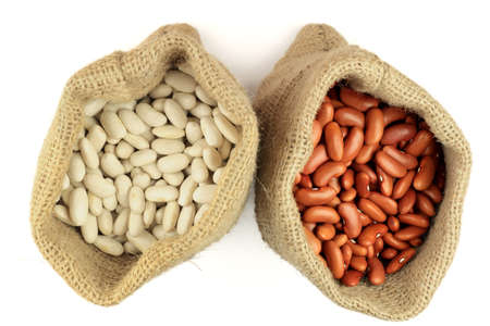 Stock Photo of White and Red Kidney Beans (legume, pulse) in burlap bags (sacks) view from top over white background.