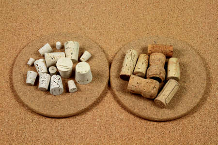 Stock Photo of Different Natural Cork products - Bottle Stoppers, Wine Closures, Bulletin Board, Cork Trivets Manufactured from natural Cork, Pressed Cork, Bleached  Medical  Cork    Фото со стока