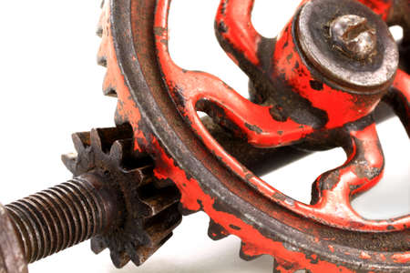 toothed: Macro Photo of Vintage  Antique, Old  Pinion  Gear, Toothed Wheels  manufactured before the W W II  over white background
