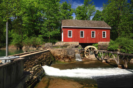 Picture, general view of old  historical building  Living Museum, Sawmill on Beaverdams Creek Ontario and small pond with pond wall and Water Wheel which was powered the water sawmill