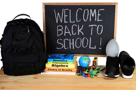 Black Chalkboard, written congratulation for Back to School, Globe toy, School Supplies, Back Pack, Running Shoes, Football ball, in combination with the text and copy books    photo