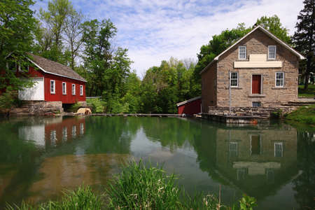 gristmill: Historical Museum Wooden and Stone Buildings of Sawmill, Gristmill and Pond part of very old Nineteen Century Industrial Complex provided services for local municipality in Ontario, Canada
