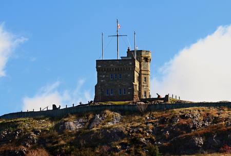 West side of Cabot Tower, top of Signal Hill and Signal Cannon - National Historical site of Canada, in St  John