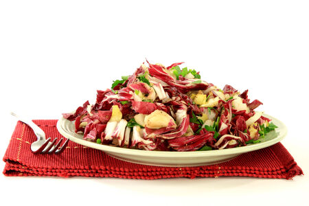 Gourmet Salad mixed chopped Fresh bulbs of Radicchio  Italian Chicory  and  Belgium Endive dressed with sea salt, grained black pepper, chopped  plain parsley and  chives, olive oil and lemon juice