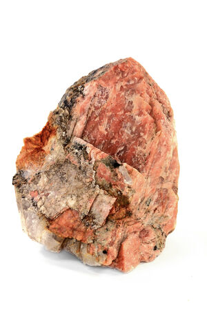 Piece of Potassium Orthoclase Feldspar with enclosures of Granite rock from which is built more than half of curst of the Earth, the striations are clear visible over the Orthoclase  pink  surface
