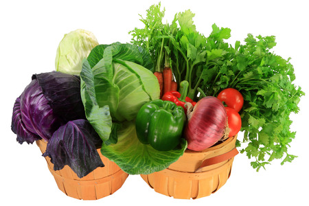 Fresh Organic Ingredients for cabbage  red, green, white flat  food stew, soups, salads, carrots, Celery, Parsley, Tomatoes, Onion, Bell Peppers in wooden bushel baskets over white background     Stok Fotoğraf