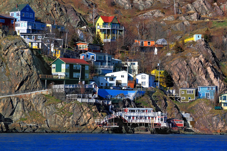 Houses of St Johns Newfoundland Canada situated over the footsteps of Signal Hill in the beginning of  The Narrows    natural channel which protect the Harbor from invasions and bad weather   Stock Photo