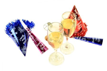 Glasses with (champagne) sparkling wine (one is with lipstick impression), cork, muselet, Party Hats and Horns remain after couple continues more intimate New Year Night Celebration