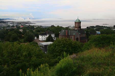 Ariel view Part of industrial region of the Saint John town and river with the same name covered with very low clouds landscape from New Brunswick