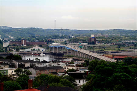 In cloudy Day, Ariel view of Landscape from Downtown of Saint John New Brunswick Canada, visible are the Harbour Bridge, part of Saint John River, Harbour in time of low tide