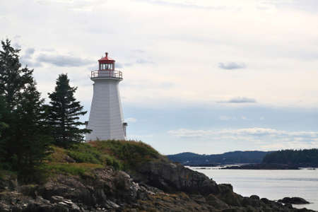 The lightstation (light house now museum) at Green�s Point, is octagonal wooden tower established in 1879 and altered in 1903 to direct boats and ships traffic trough LEtete Passage Bay of Fundy Editorial