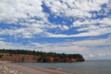 Popular tourist attraction Sea Caves formed from tidal erosion in New Brunswick clay geological structure of coastal line around St. Martins in Bay of Fundy accessible by kayak during high tide.