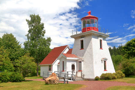 New Brunswick, St. Martins Tourist Information Center (centre) build as replica of old existing Light House servicing Marina for lobster and crab fisher boats of St. Martins
