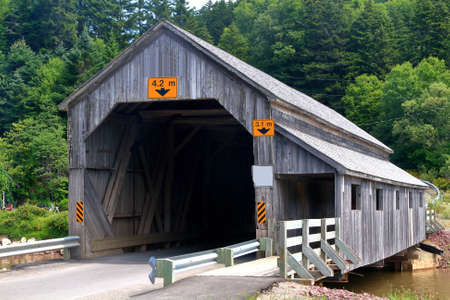 Covered wooden bridge Irish River Number 2 in St. Martins New Brunswick still in use visible is pedestrian section of the bridge built in 1946 Stock Photo