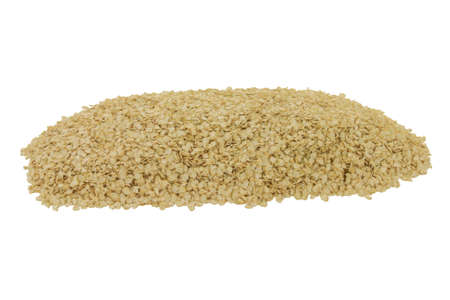 Processed to Flakes Organic Quinoa seeds spilled on pile over white background - isolated Stock Photo