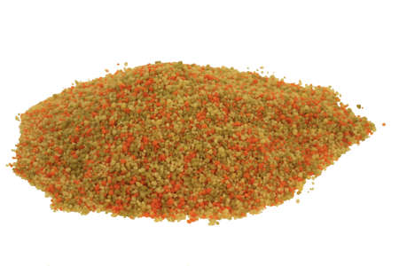 Raw, uncooked Tri-colored (Tricolor), (Tri color) cous-cous (couscous) colured with tomato and spinach powders spilled on pile, over white background - isolated