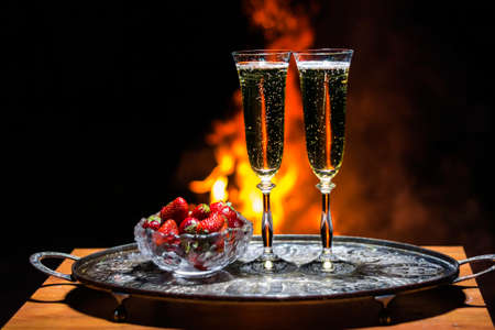 flame background: two glasses of champagne with flame on background