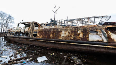 abandoned rusty ship in polluted river