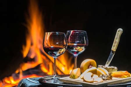 two glasses of wine on the background of fire Stock Photo