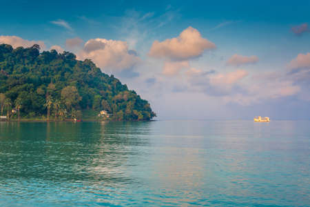 white ship in the tropical bay photo