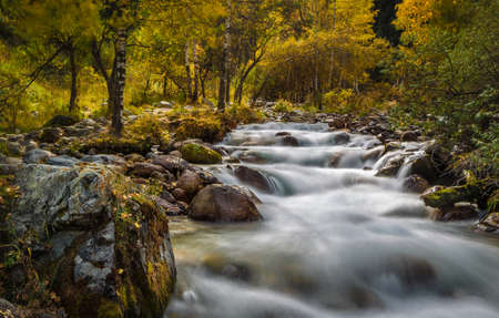 watershed: mountain river rapids in autumn Stock Photo