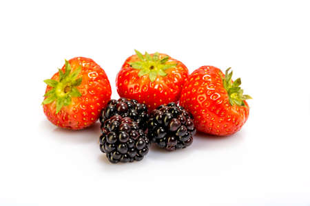 strawberries and blackberries on a white background photo