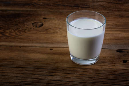 glass of milk on wooden background Stock Photo