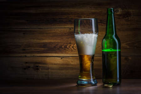 beer glass and bottle on a wooden background