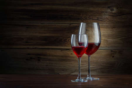 glasses of wine on a wooden background photo