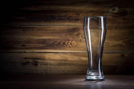 empty beer glass on a wooden background Stock Photo