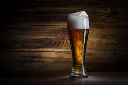 glass of beer on a wooden background Stock Photo