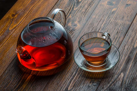 glass teapot on a wooden table
