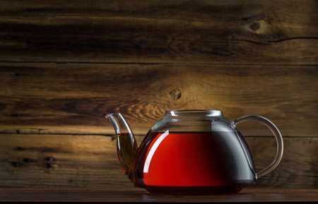 glass teapot on a wooden background