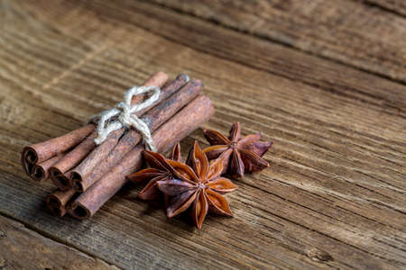 cinnamon on a wooden background Stock Photo