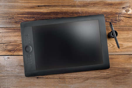 Graphics tablet Pen&Touch on a wooden background