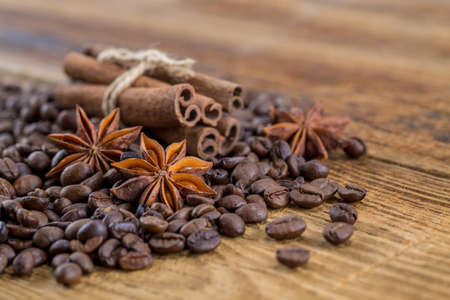 Coffee grains, anise and canella on old planks