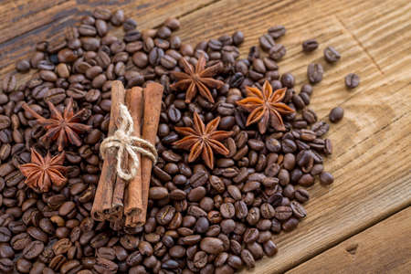 Background texture of grains of coffee cinnamon and anise stars Stock Photo